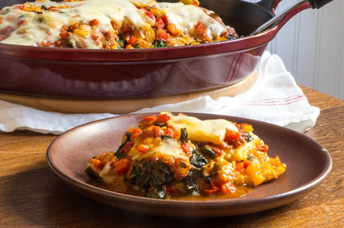 Vegetarian polenta lasagna with swiss chard and sweet peppers.