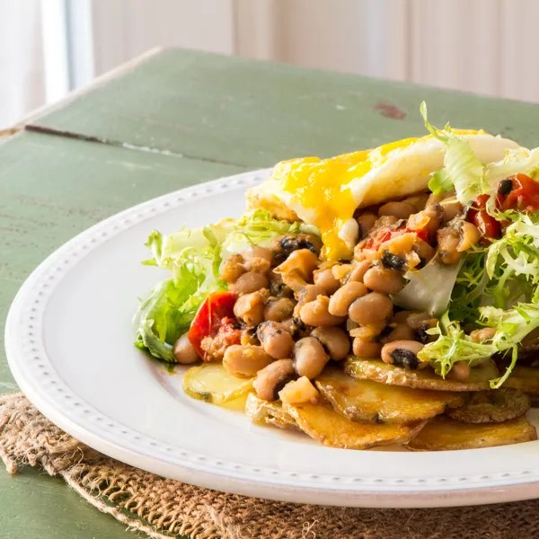 Black-eyed pea with frisée and a fried egg