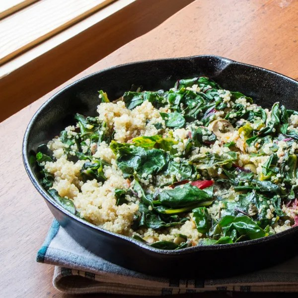 Lemony Swiss chard and quinoa sauté with capers and olives