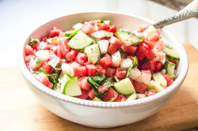 Refreshing salsa made with seedless watermelon, peaches, cucumbers and a little Serrano pepper. Serve it with chips, goat cheese, or as a topping.