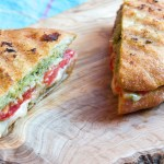Caprese panini with pesto, grilled tomatoes and melted mozzarella.