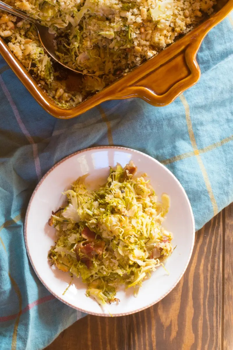 Brussels sprouts gratin with quinoa, bacon, and dried cranberries, topped with maple-butter breadcrumbs and pine nuts. #vegetariandinner #brusselssprouts #brusselssproutscasserole