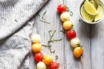 Melon balls dunked in lime, honey and ginger, and then slid onto skewers. A final flourish of mint finishes them off.