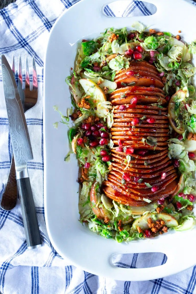 Delicious, gorgeous vegan entrée for Thanksgiving or any special occasion. Step-by-step instructions to hasselback butternut squash are included, with photos for each step.