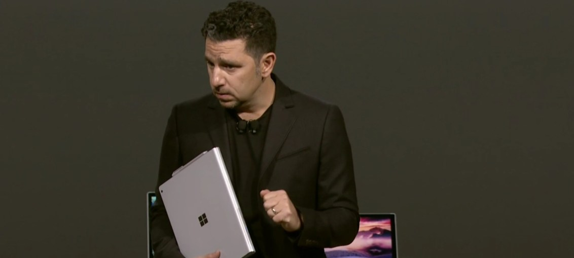 Panos Panay holding a Surface device