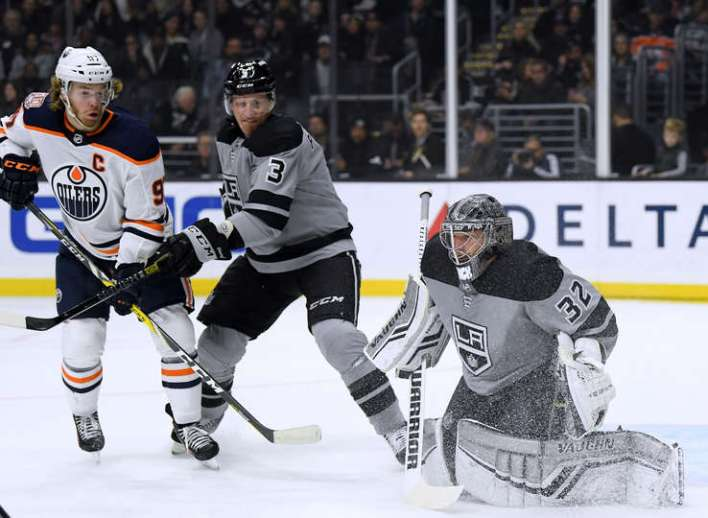LOS ANGELES, CALIFORNIA - JANUARY 05: Jonathan Quick #32 of the Los Angeles Kings makes a save in front of Connor McDavid #97 of the Edmonton Oilers and Dion Phaneuf #3 during the first period at Staples Center on January 05, 2019 in Los Angeles, California. (Photo by Harry How/Getty Images)