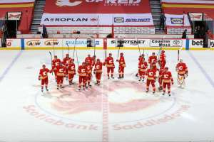 CALGARY, AB - MAY 19: The Calgary Flames salute the C of Red after a win against the Vancouver Canucks at Scotiabank Saddledome on May 19, 2021 in Calgary, Alberta, Canada. (Photo by Gerry Thomas/NHLI via Getty Images)