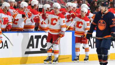 EDMONTON, AB - OCTOBER 16: Sean Monahan #23 and Dillon Dube #29 of the Calgary Flames celebrate after a goal during the second period in the game against the Edmonton Oilers on October 16, 2021 at Rogers Place in Edmonton, Alberta, Canada. (Photo by Andy Devlin/NHLI via Getty Images)