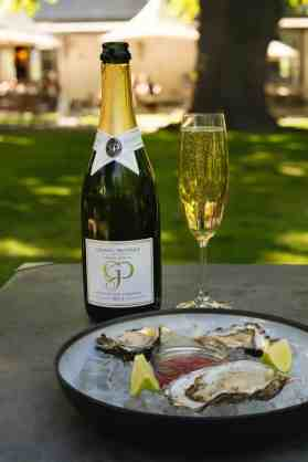 Grande Provence MCC and Oyster tasting portrait with bottle in focus HR (1)
