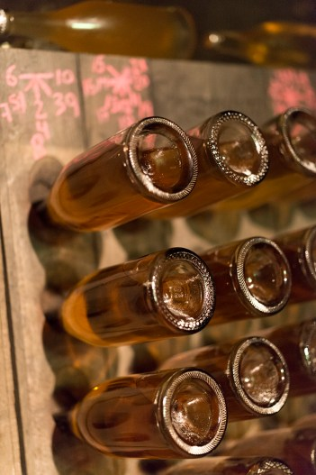 Sample bottles in a riddling rack in the Schramsberg cave