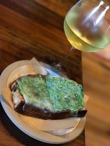 Garlic Tartine with pea pesto and lardo - by Chef Christopher Kostow