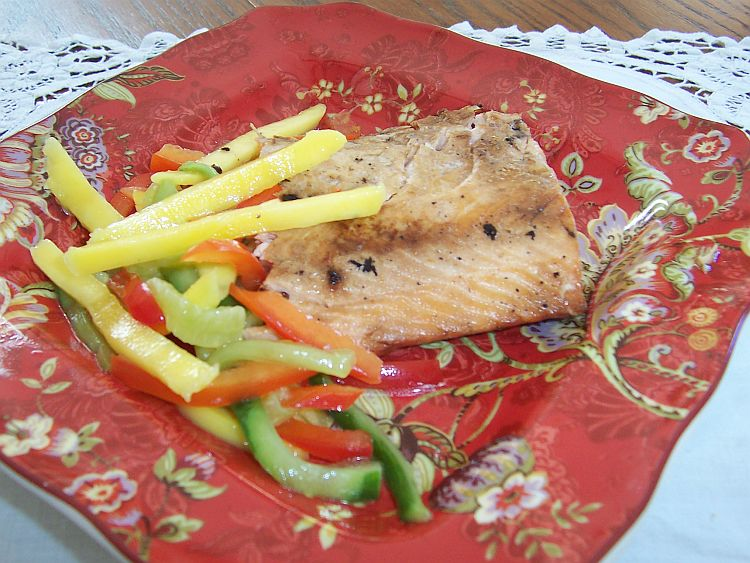 Grilled salmon with ginger and soy sauce on red Oriental pattern plate