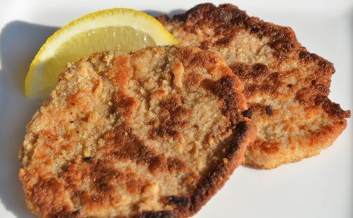 Oktoberfest Schnitzel on plate with lemon wedge
