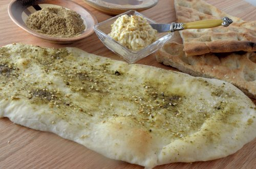 Middle Eastern flat bread with hummus on the side