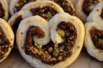 date-pistachio-palmiers-cooked-on-serving-board
