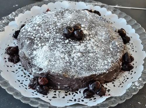 Flourless Chocolate Cake Garnished with Cherries