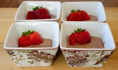 Chocolate non-dairy ice cream garnished with fresh strawberries