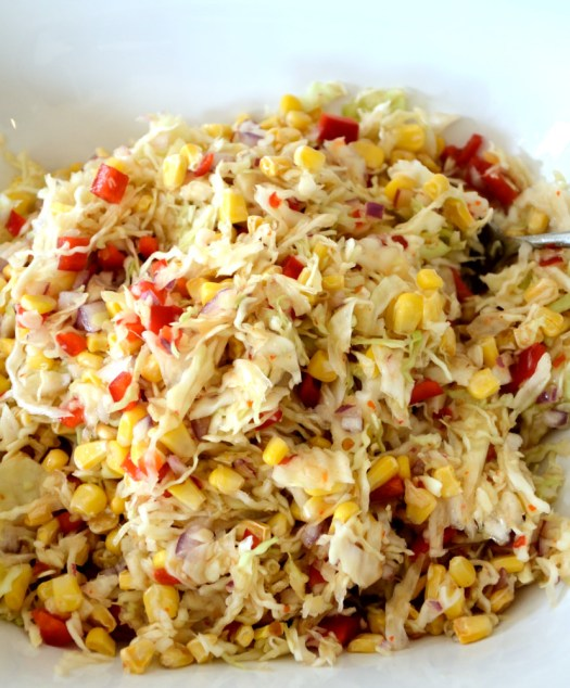 This Healthy Cole Slaw is fat free and full of flavour! Cabbage, corn and peppers are mixed in a spicy, sweet and sour dressing.