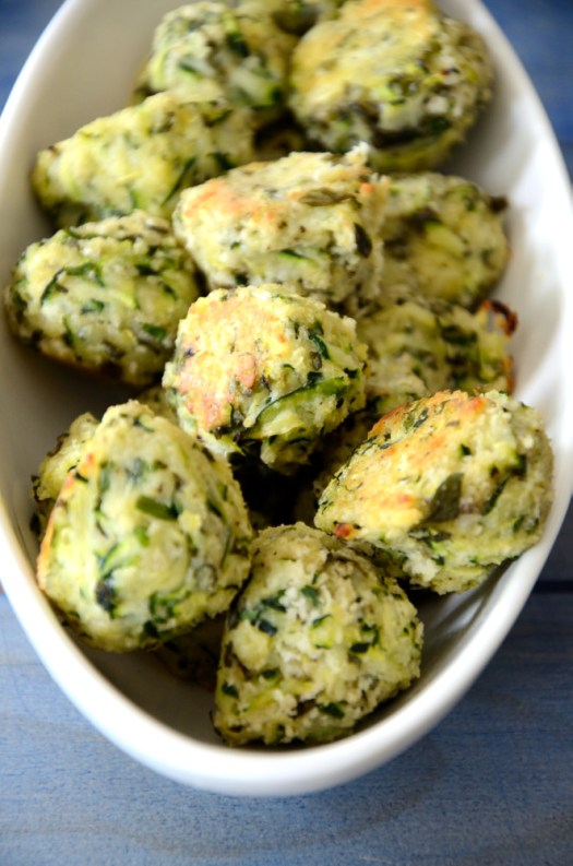 These tasty little Herbed Zucchini Bites are perfect to use up some of that zucchini that is everywhere at this time of year! Fresh herbs take them from ho hum to delicious!