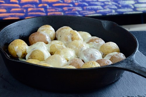 Raclette and Gourmet Potatoes in Cast Iron Skillet