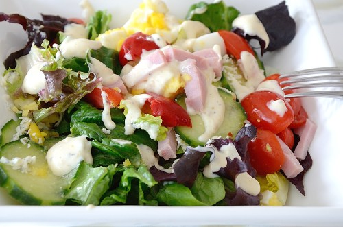 Chef's saladwith creamy dressing in a bowl