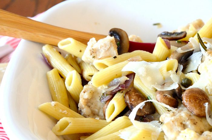 bowl of penne with mushrooms and spoon