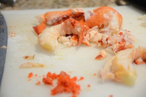 Tail meat and roe extracted from lobster carcass