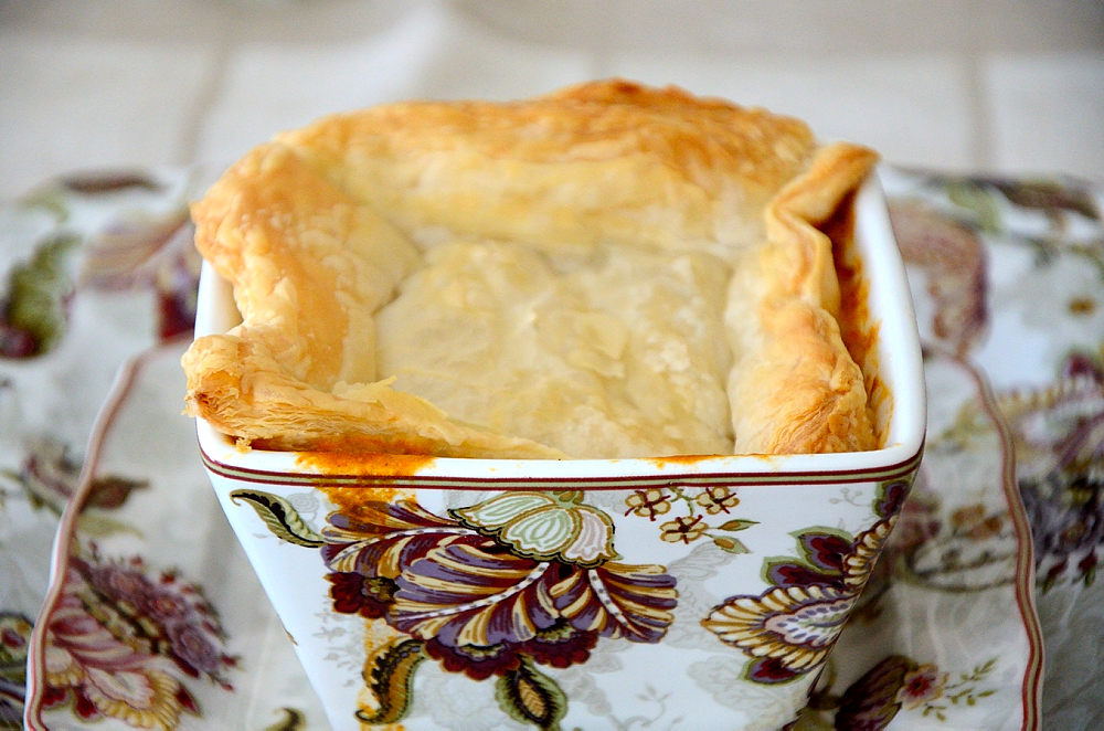 Square soup bowl of lobster bisque with puff pastry topping