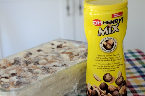 Oh Henry mix container in front of ice box cake