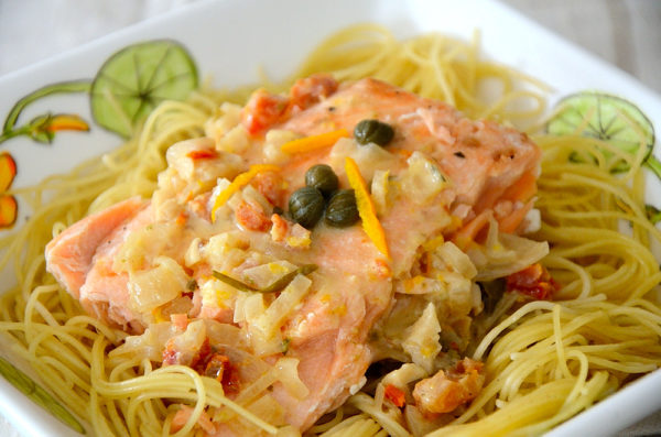Salmon with Citrus cream on Angel Hair Pasta with caper and orange peel garnish