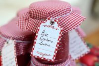 Half pint jar of pear cranberry butter with gingham cap and label