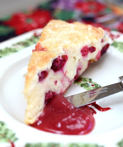 Individual scone on a plate with cranberry pear butter
