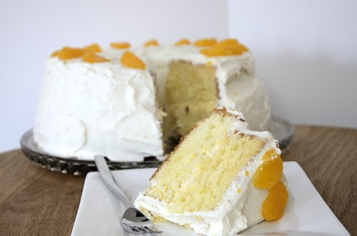 Mandarin Chiffon Layer cake with Yogurt Cream Cheese Frosting and decorated with mandarin pieces