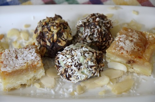 3 chocolate covered ice cream truffles rolled in toasted almonds and toasted coconut.