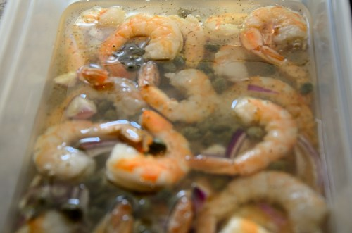 Jumbo shrimp and red onions marinating