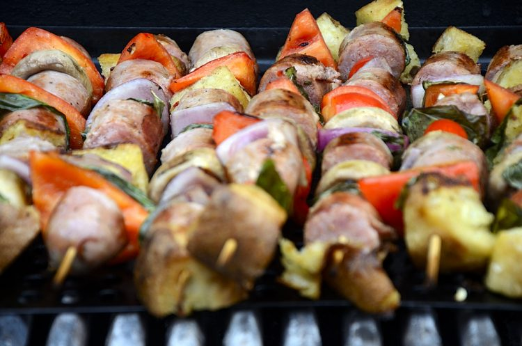 Panzanella Skewers on the grill with sausage,mushrooms, peppers, onion, basil and ciabatta bread cubes