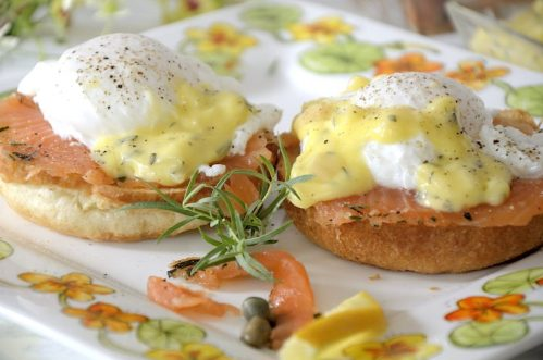 two poached eggs on croissant buns with cured salmon and bearnaise sauce.