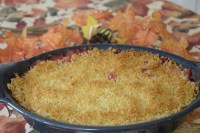 Casserole of layered root vegetables with bechamel, cheese and panko topping.