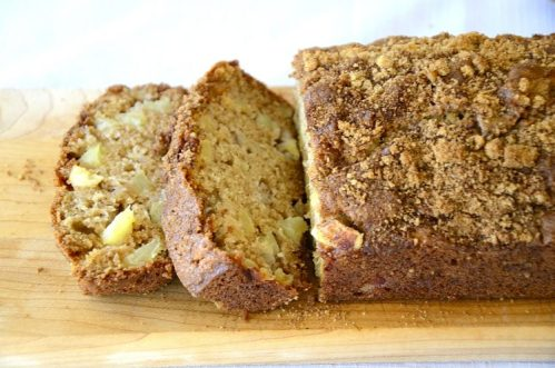 Loaf of Cinnamon Apple quick bread with brown sugar and cinnamon topping.