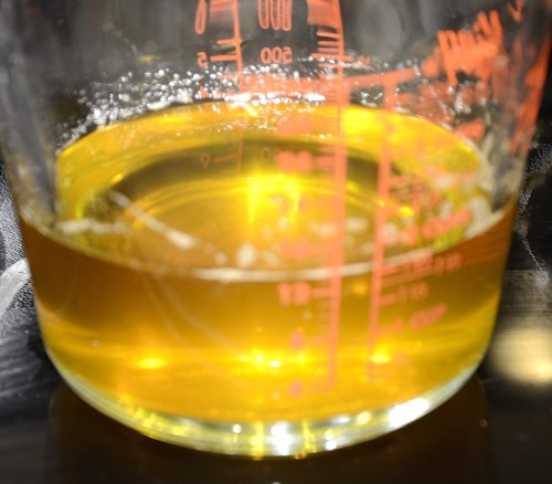 strained ghee in a measuring cup.