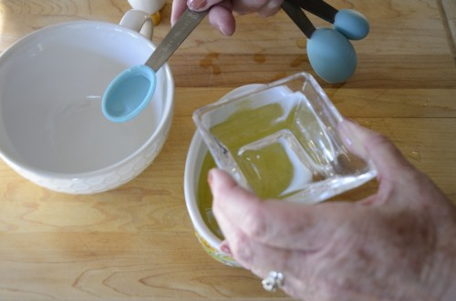 Adding 1/2 tsp of water to the new container.