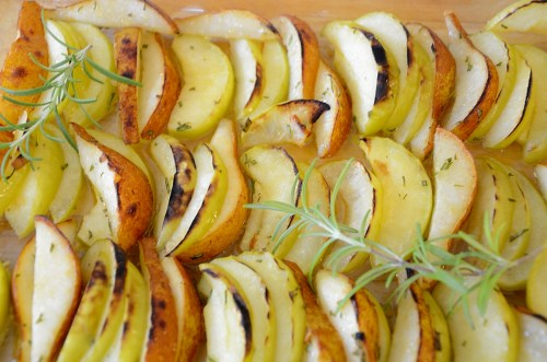 Broiled slices of apples and pears on broiler pan.