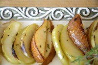 Broiled slices of apples and pears on serving dish.