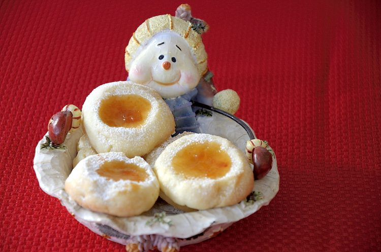 apricot filled thumbprint cookies in a snowman christmas plate.