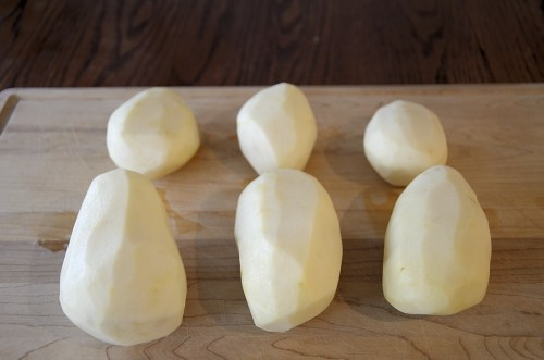 Russet potatoes peeled and ready to cut up for English Roasted Potatoes.