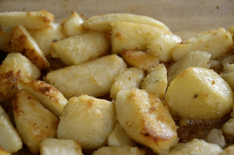 Browned crispy English Roasted Potatoes fresh from the oven.