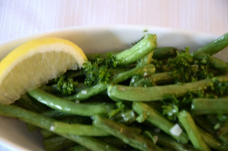 Green beans tossed in melted butter/oil with garlic and lemon juice.