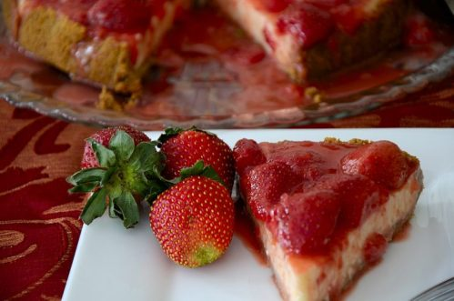 Slice of strawberry cheesecake on a plate.