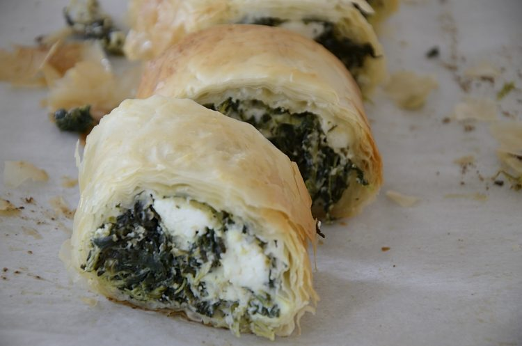 Slices of flaky phyllo filled with spinach and feta cheese.