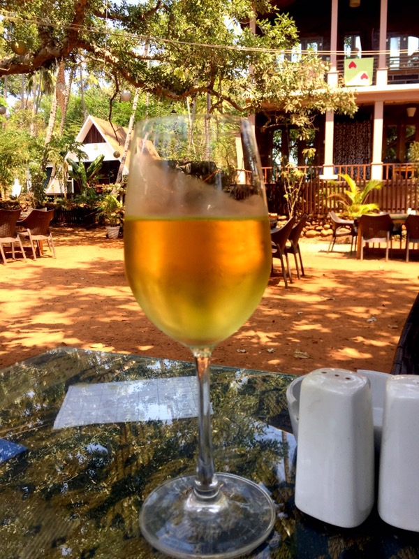 a glass of Big Banyan chenin blanc at La La Land restaurant, Goa, India